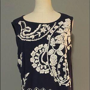 Gently worn woman's sleeveless shirt.